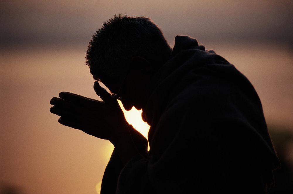 o-PRIEST-PRAYING-facebook.jpg