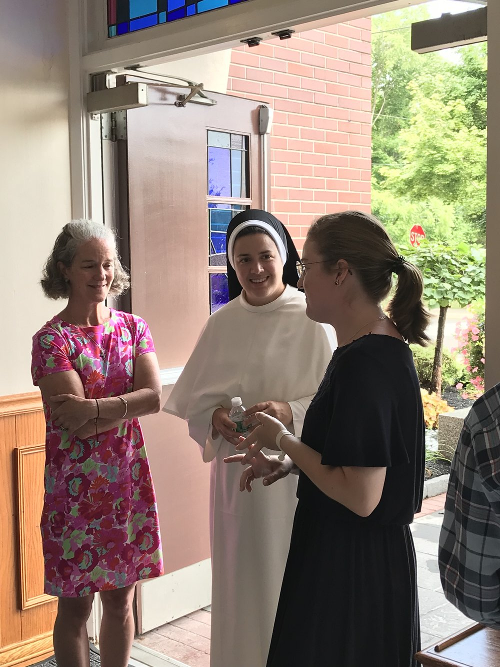 Sr. Maria Francesca, O.P.  chats with Laura and her mother at the reception following Mass.
