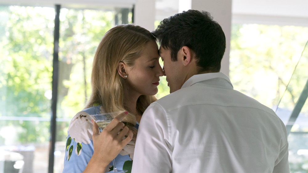 Emily (Blake Lively) at left and Sean (Henry Golding) at right
