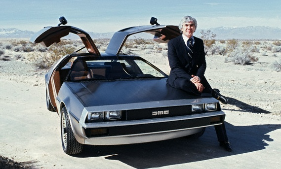 John DeLorean with his new company's first production car, the DMC-12