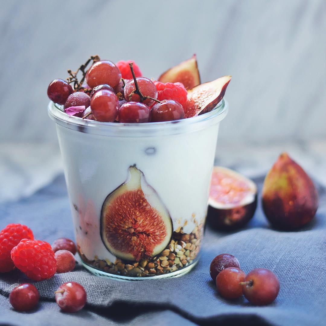 Coconut yogurt, granola, and buckwheat parfait with figs