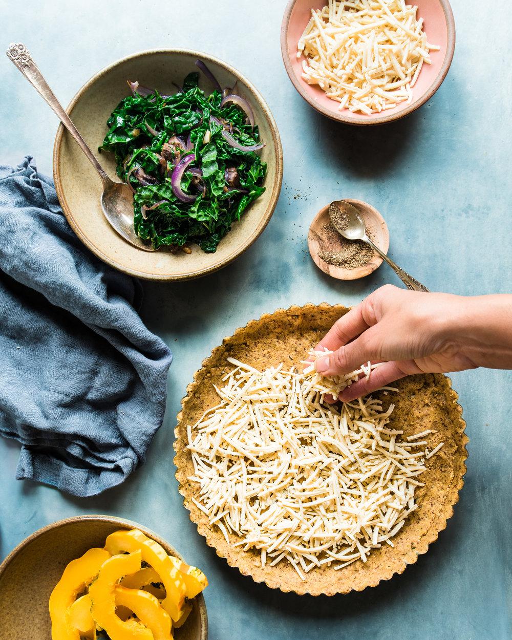 squash kale tart ingredients adding more cheese (1 of 1).jpg