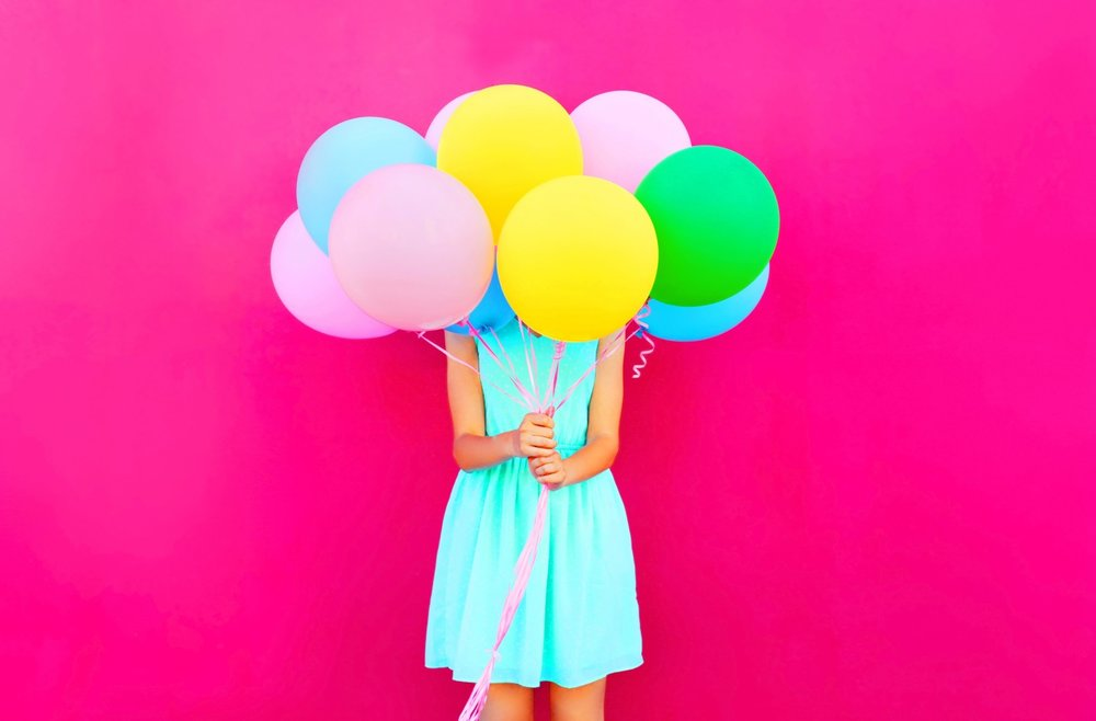 woman-holding-balloons