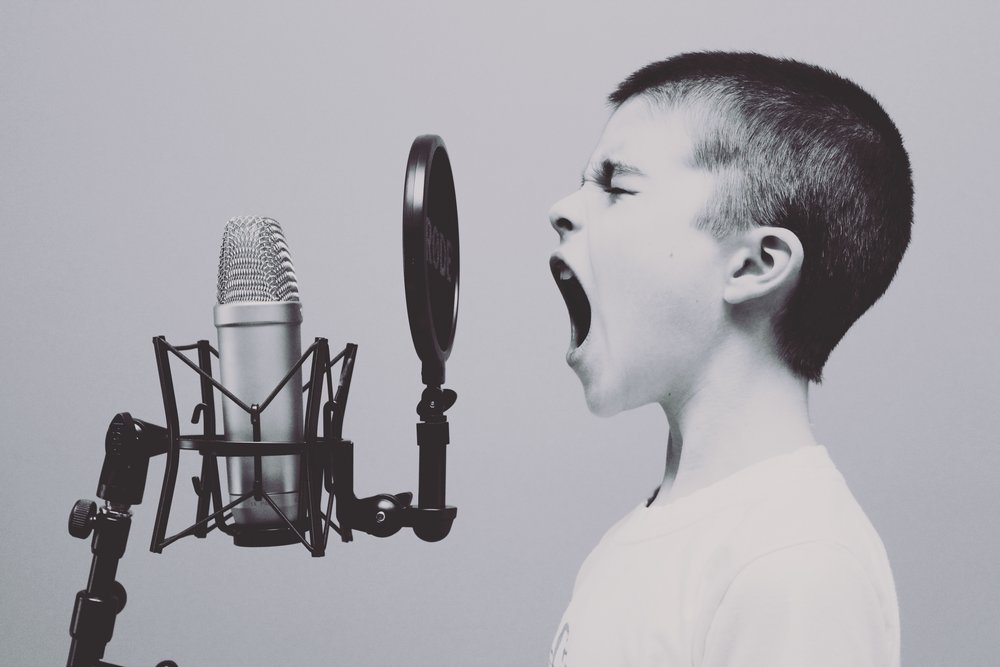 boy talking into microphone