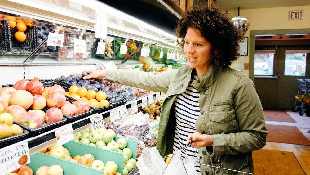 High Falls Food Co-op Member and cookbook author, Julia Turshen, browses our produce..