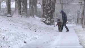 stock-footage-young-child-and-mother-bundled-up-in-winter-gear-walk-in-snow-storm-in-portland-oregon-300x169.jpg