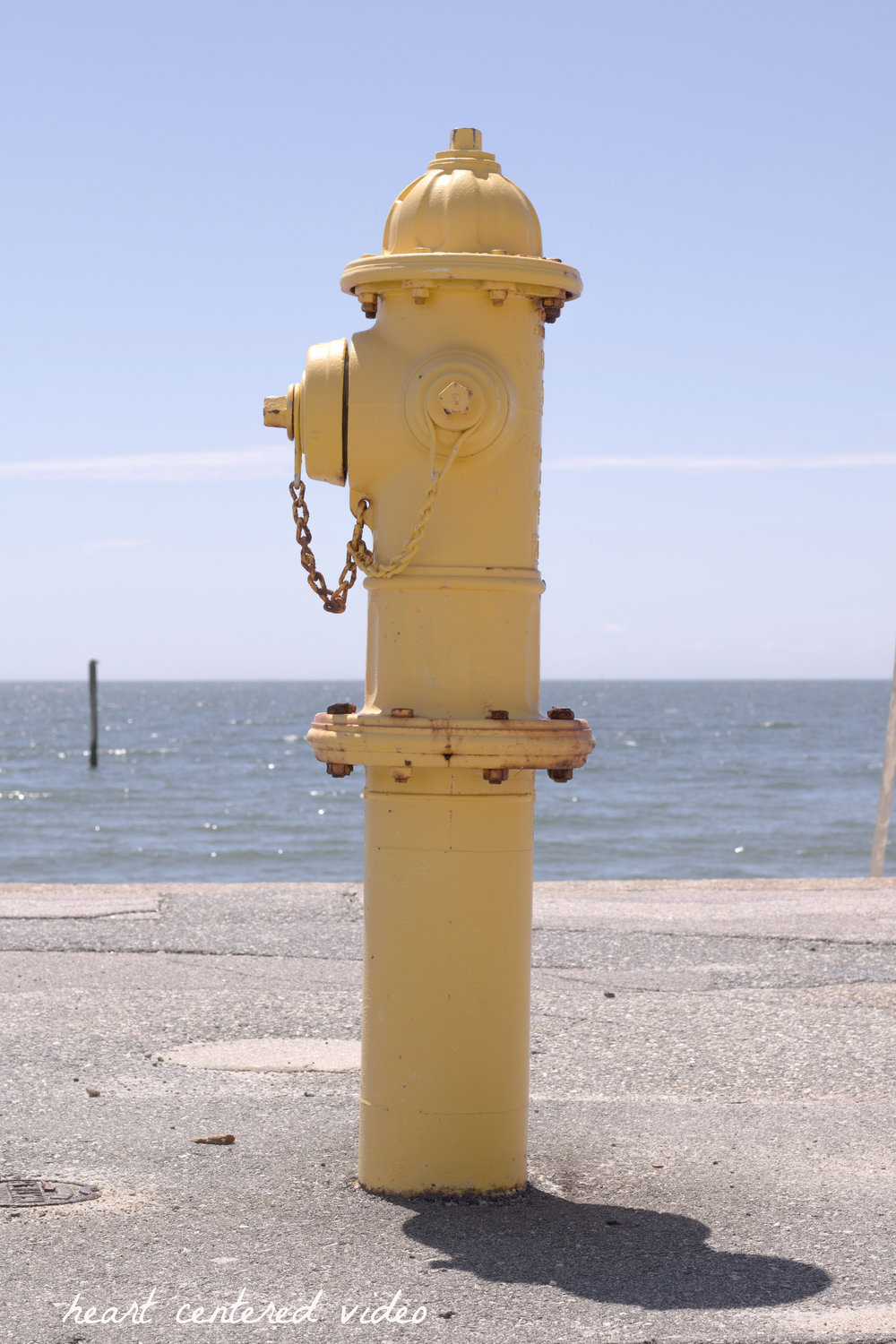 yellow fire hydrant at the beach