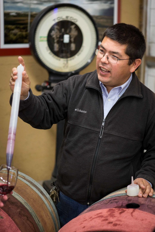 Owner and winemaker Martin Fujishin pours barrel samples
