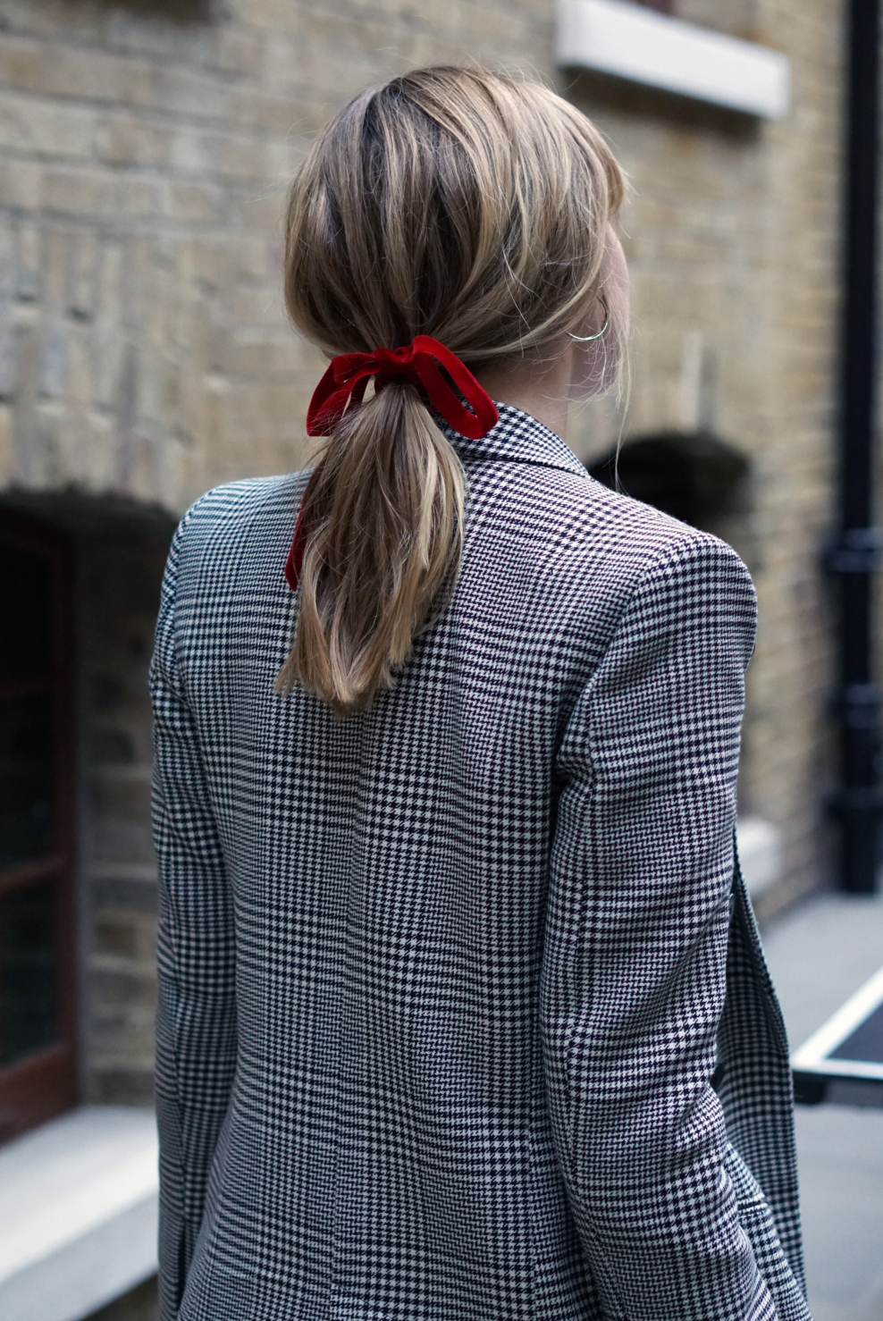 - Taking me right back to my youth (and by youth I mean first school on photo day), a ribbon tied pony-tail is the unexpected styling trick I just can't get enough of right now. It caught my eye on the street during Copenhagen Fashion Week and has since become a fix-all move; solving bad hair days and updating boring outfits aplenty. And all for a mere £2.34 for 0.8m in the John Lewis haberdashery department.Wearing Jennifer Fisher earrings and Zara blazer