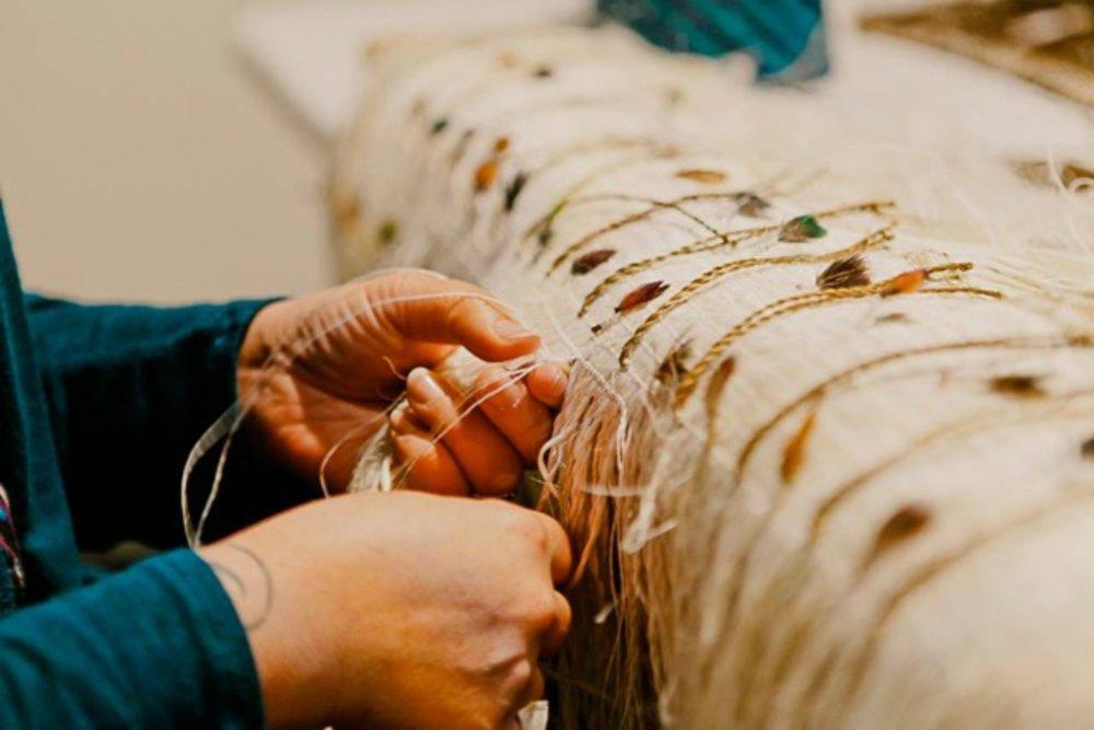 Veranoa Hetet weaving Korowai (cloak) for her mokopuna (granchild)  hetetschoolofmaoriart.co.nz