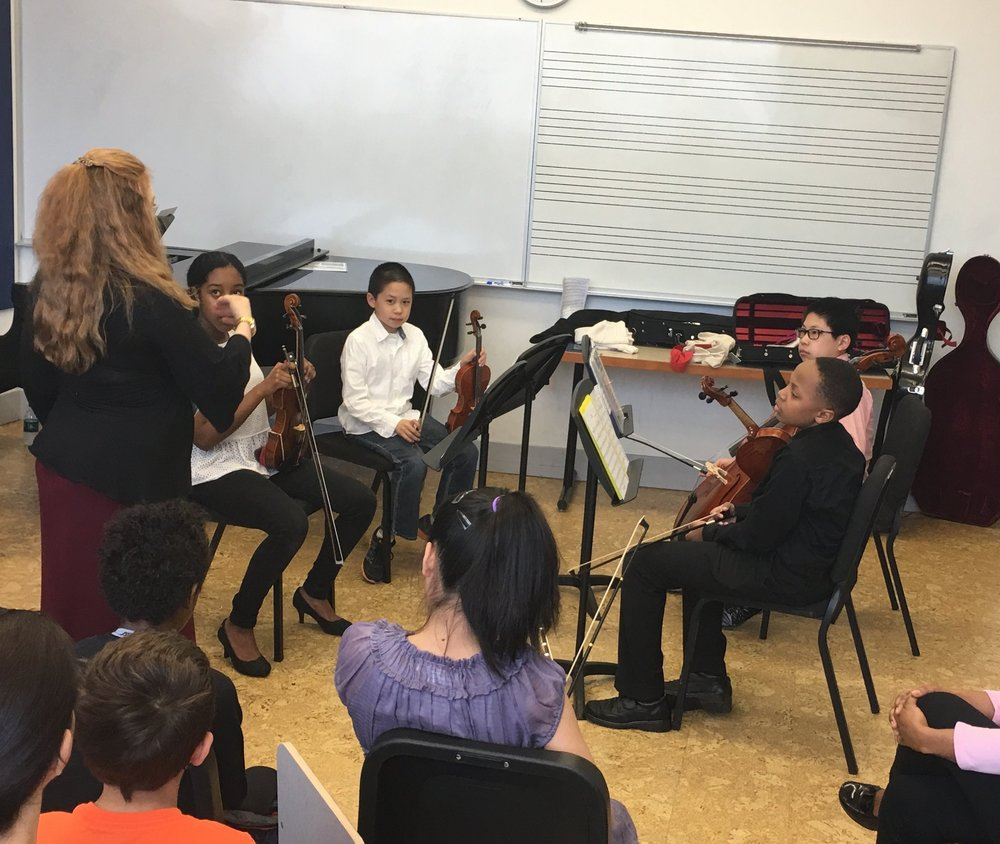The string quartet learns how to be sensitive ensemble players from Ms. Pine.