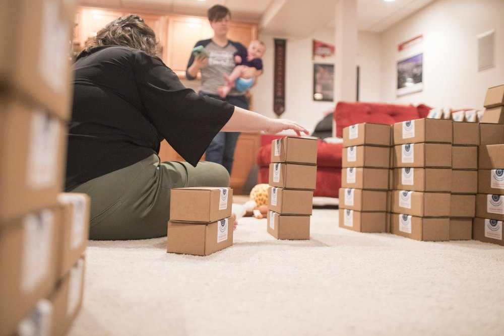 Intern Molly organizing cookies.  Photo Credit: Mhari Shaw.