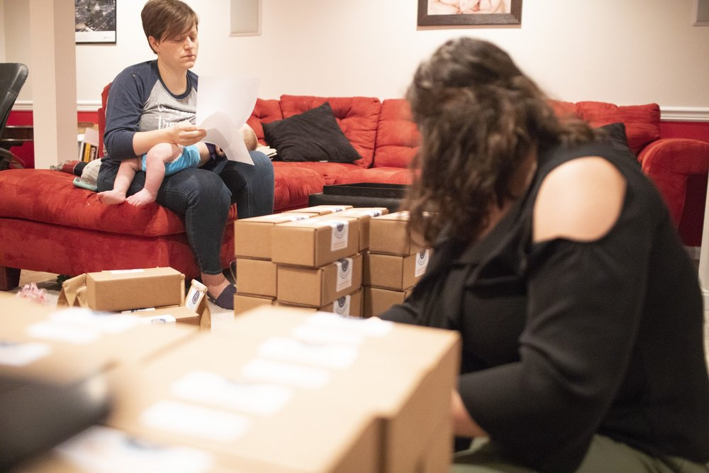 Breastfeeding while our intern Molly worked.  Photo Credit: Mhari Shaw.