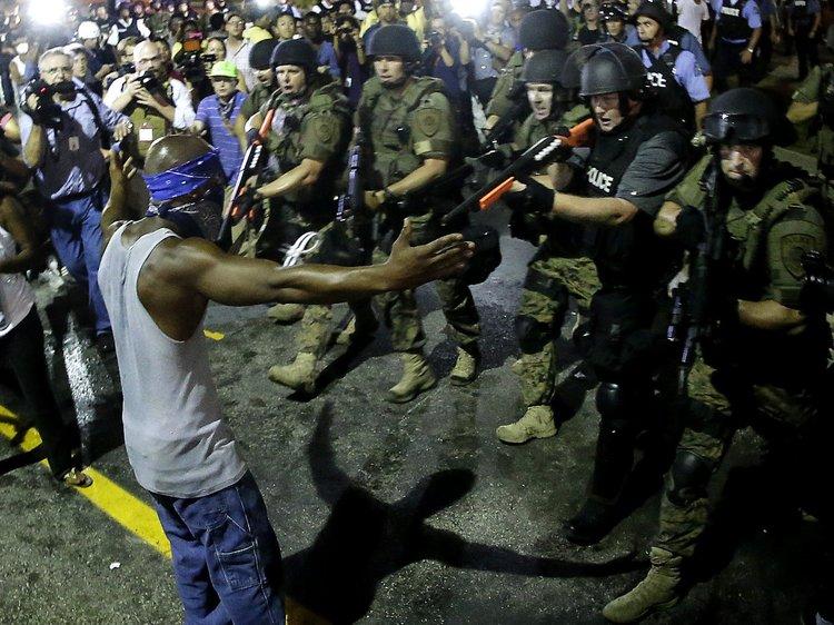 Our people resisting in Ferguson, Missouri.  Credit: Charlie Riedel/AP