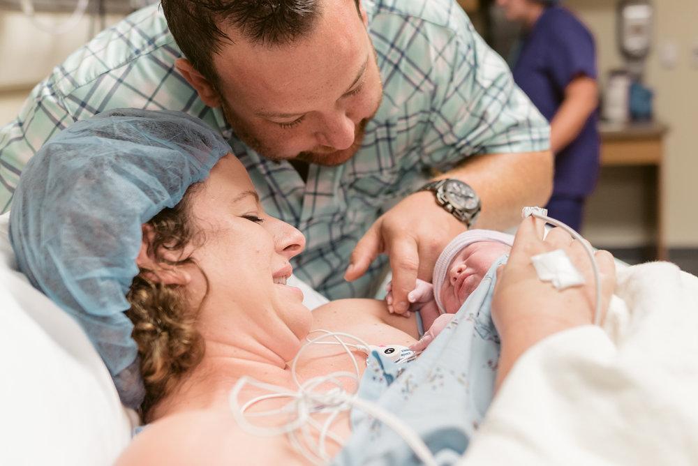 newborn.poplar.bluff.regional.medical.center.artist.by.heart.photography.holding.hands
