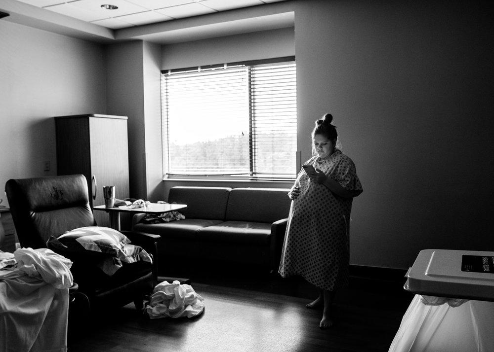 birth.photography.window.walking.phone