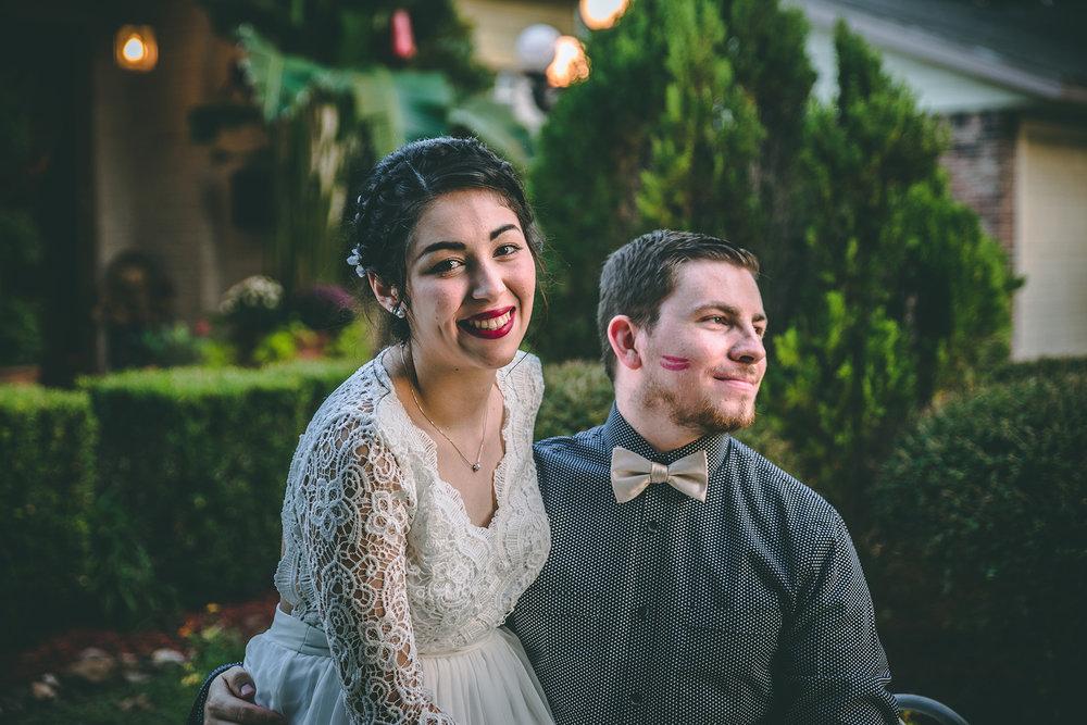 Bride leaves lipstick on grooms cheek