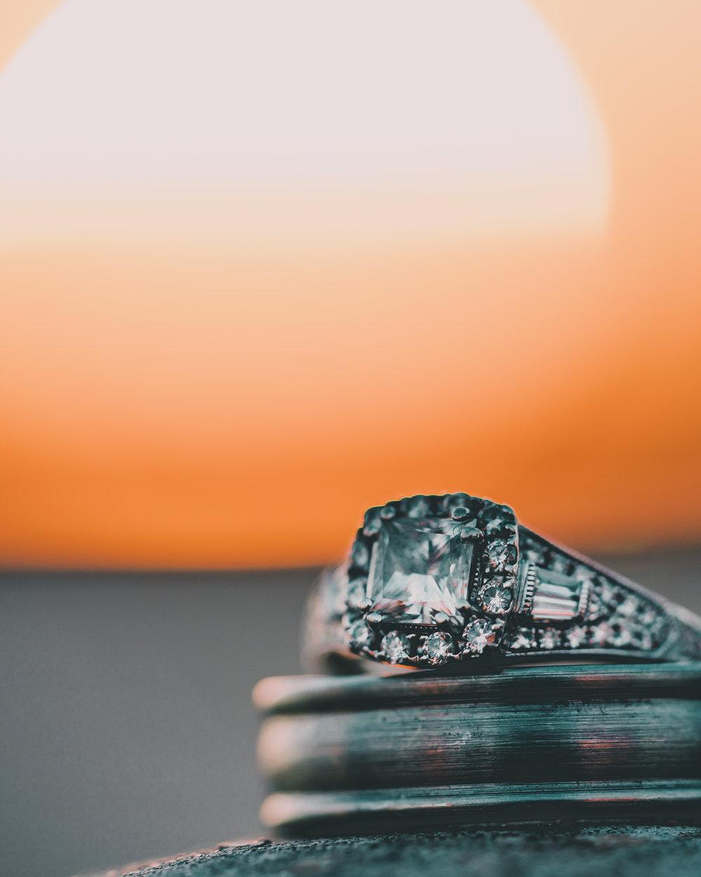 Wedding rings at sunset