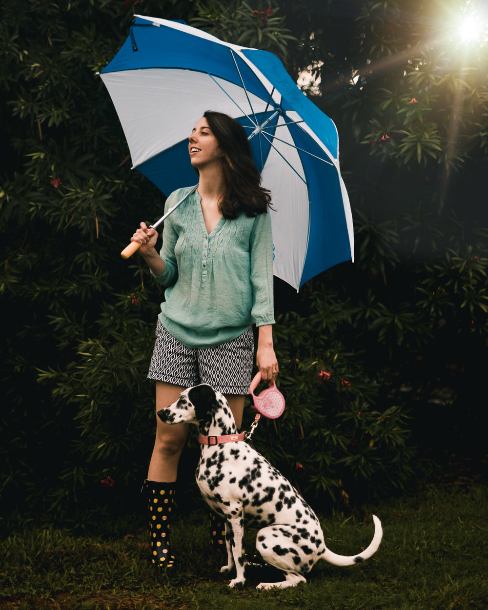 Red head with umbrella and dalmatian