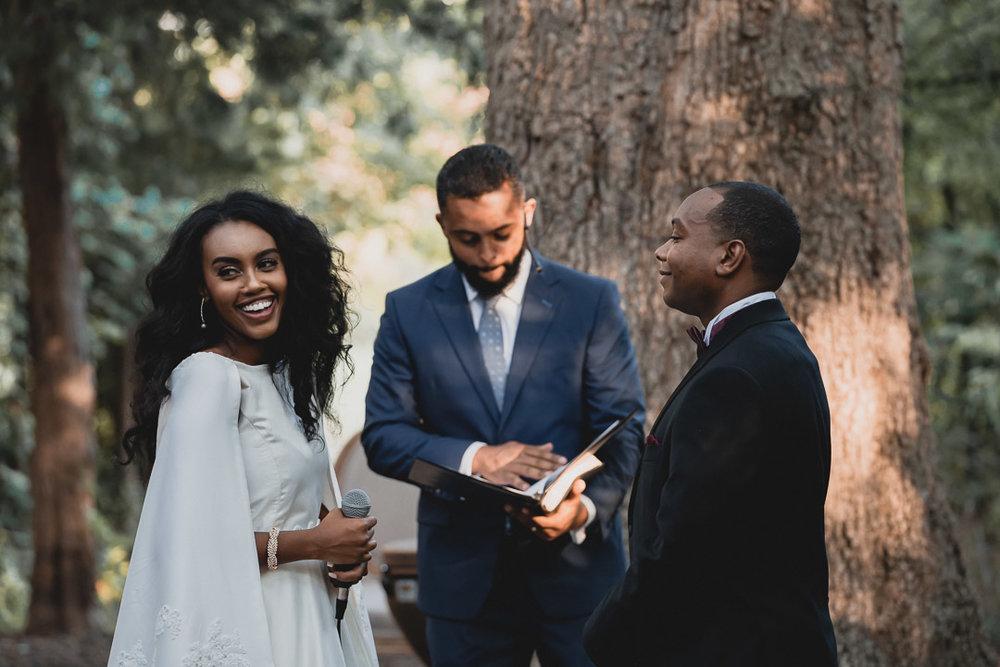 Bride laughs during ceremony