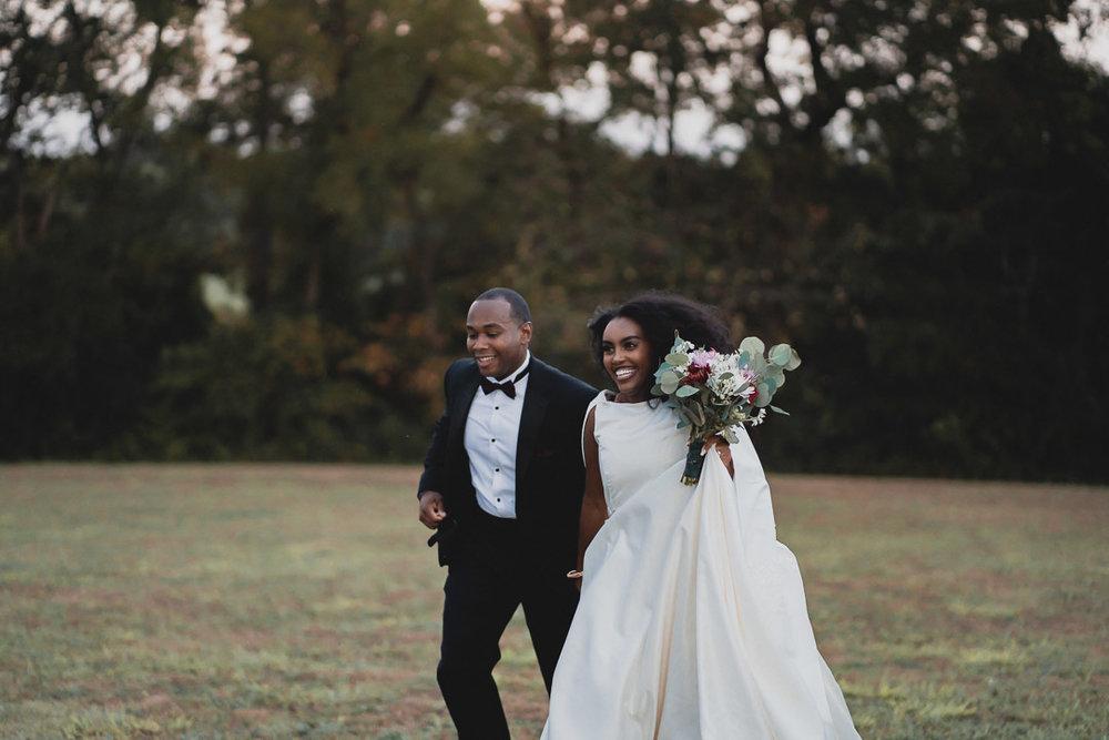 Bride and Groom Running in field