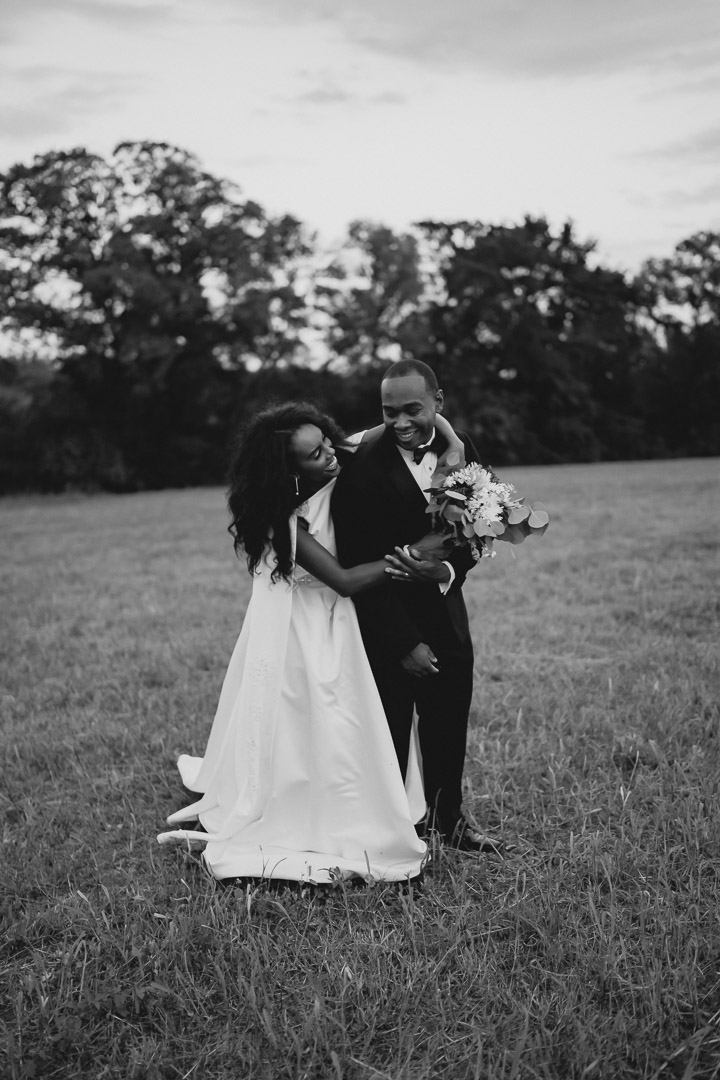 Bride embracing Groom from behind