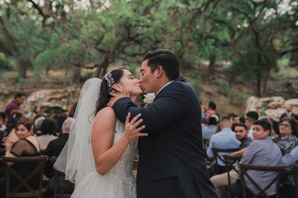 Bride and Groom kissing during their ceremony exit