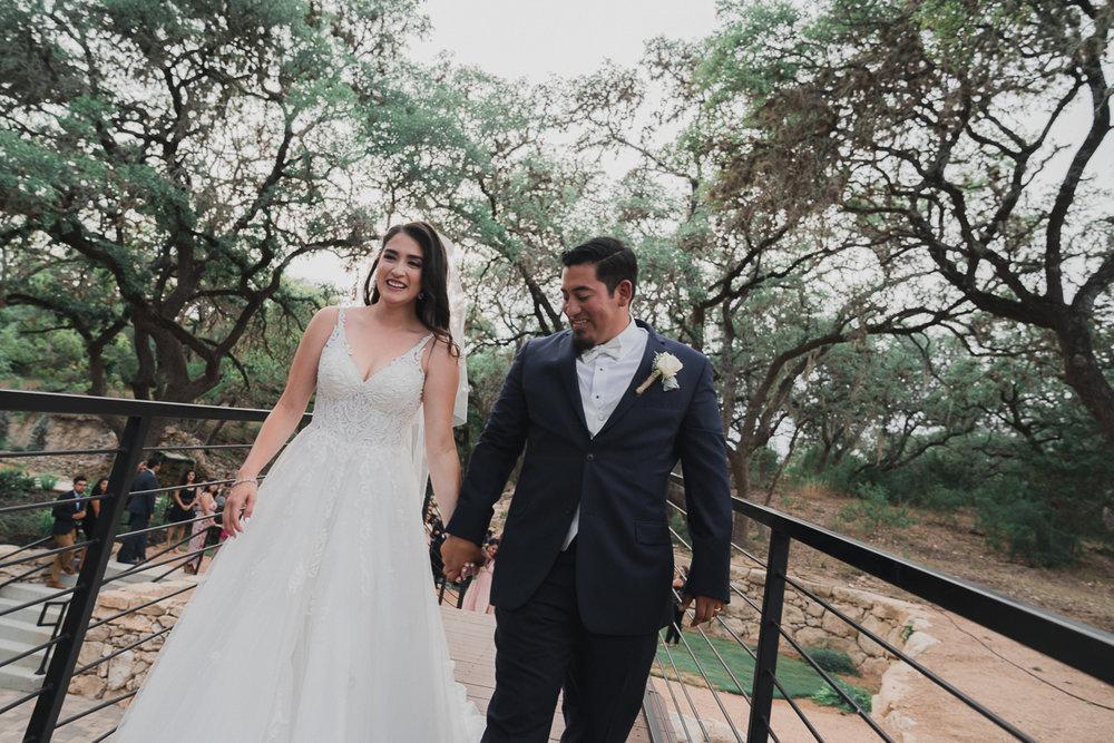 Bride and Groom exiting over a bridge