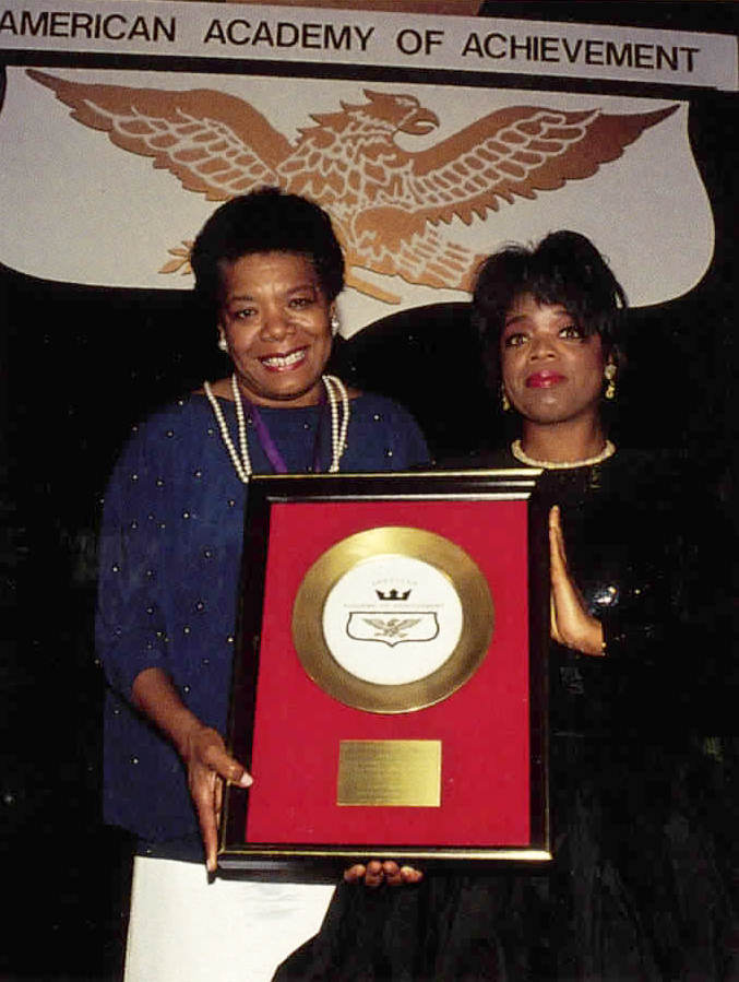 Awards Council member and the Banquet moderator Oprah Winfrey presents the American Academy of Achievement's Golden Plate Award to Maya Angelou during 1990 Achievement Summit in Chicago, Illinois.