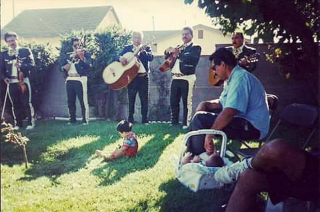 Richard Perez, seated, with infant son Christian, at a family party in Oxnard, California.