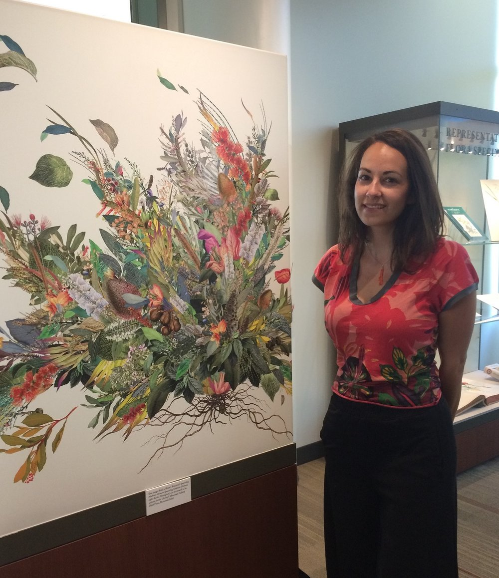 "Art professor Rose Briccetti poses a print of her digital collage ""Sprawling Neobiotic Chimera."""
