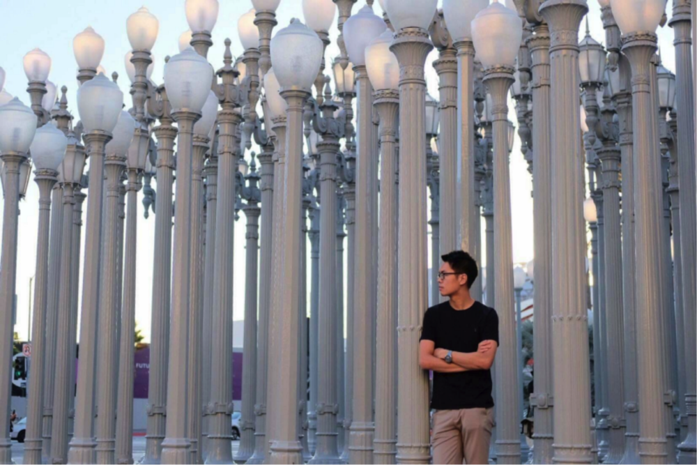 Weihao Qiu, a UC Santa Barbara Media and Technology student, visits LACMA's Urban Light installation.