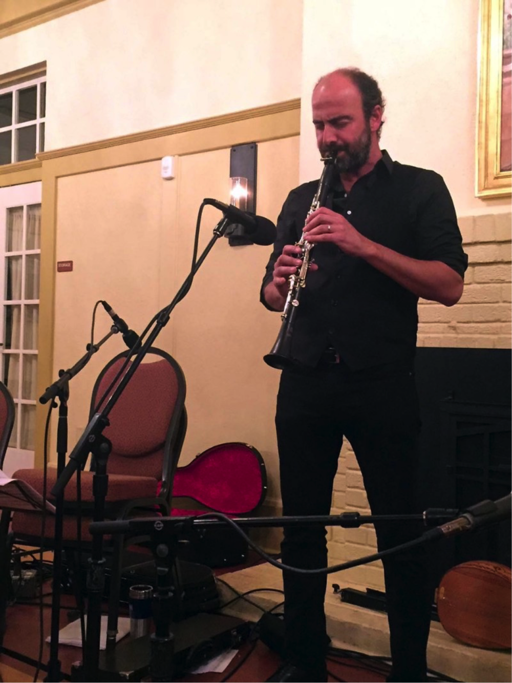 Kinan Azmeh and his clarinet fuse together in an instrumental piece dedicated to the Islamic philosopher-poet Ibn 'Arabi. (Photo by Jane Carroll)
