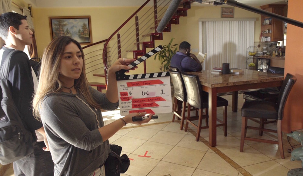 Aryana Moreno prepping the clapperboard for her next film project,  Yours Truly.