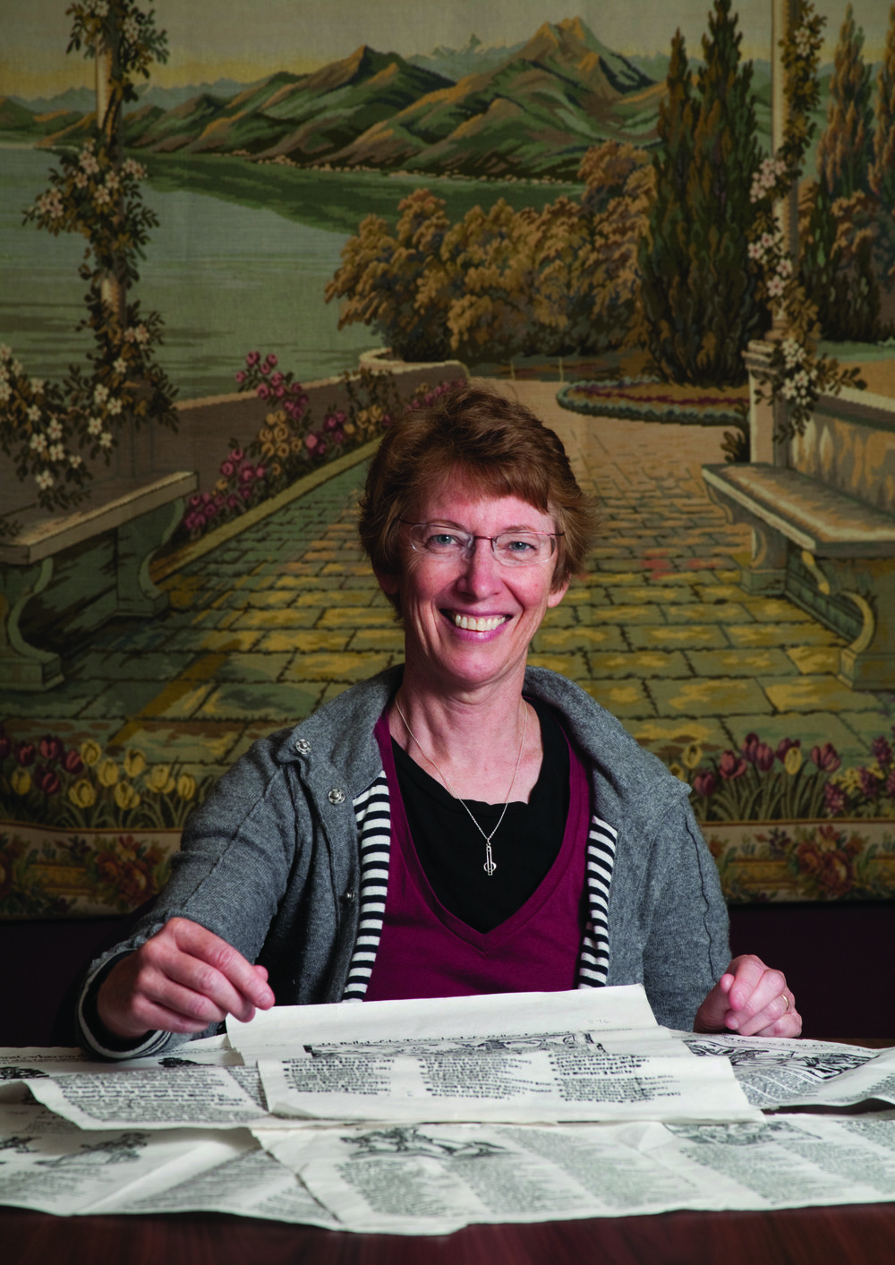 English Professor Patricia Fumerton is pictured with early broadside ballads.