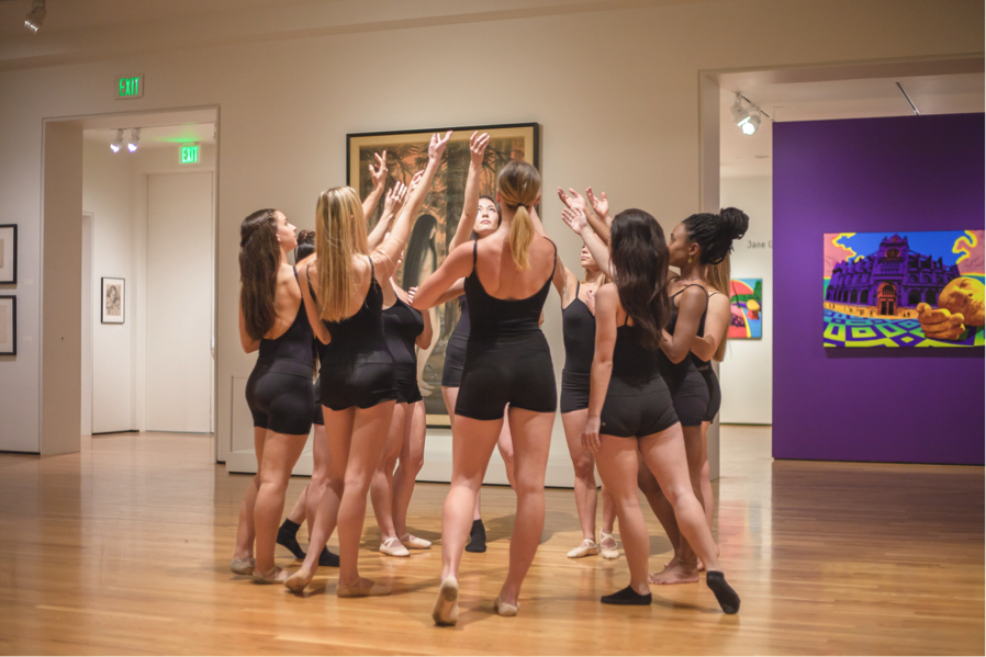 Dancers came together at the end of  Still We Rise,  a performance in support of DACA recipients at the Art, Design & Architecture Museum.  Photo by Lianna Xiaokui Nakashima,    LXNPhotography.com
