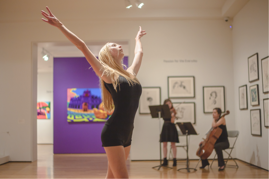 A student performer  in Monique Meunier's  Still We Rise  dances to live music at the Art, Design & Architecture Museum .  Photo by Lianna Xiaokui Nakashima,  LXNPhotography.com