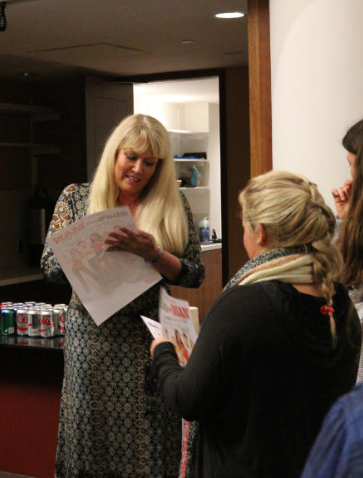 Script to Screen: Screenwriter Karen McCullah signs transfer student Katherine Grayson's  event poster after a screening of  She's the Man.