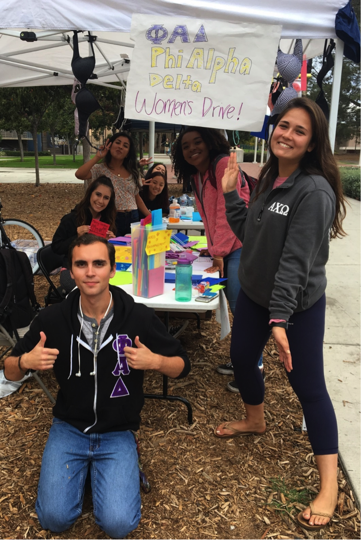 We were all smiles - men and women - when donations of feminine products started pouring in for the event.