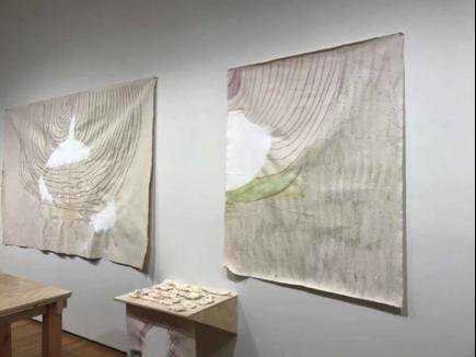 MFA graduate Daria Izad's multimedia art features raw canvas, ceramic, and wood pieces.
