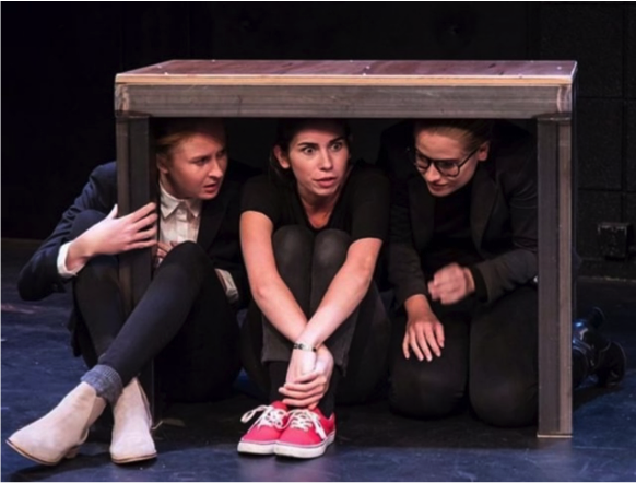Blake Thompson (left), a third-year student at UC Santa Barbara, performs with two of her fellow student actors .