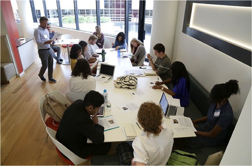 Eric Hoover, senior writer at the Chronicle of Higher Education, leads a writing workshop for the students. last summer in Washington, D.C. Photo by Julia Schmalz