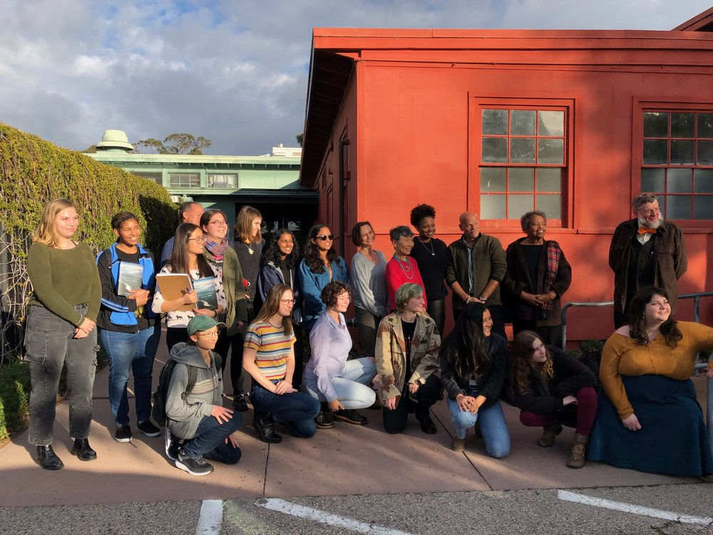 UCSB students and faculty posing with U.S. Poet Laureate Tracy K. Smith after her talk, in front of the Old Little Theater.