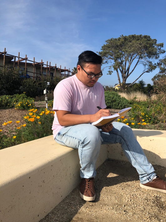 Tomas Palpallatoc, a first-year UCSB sociology major, writing fresh poetry in preparation for his final Poetry Slam.
