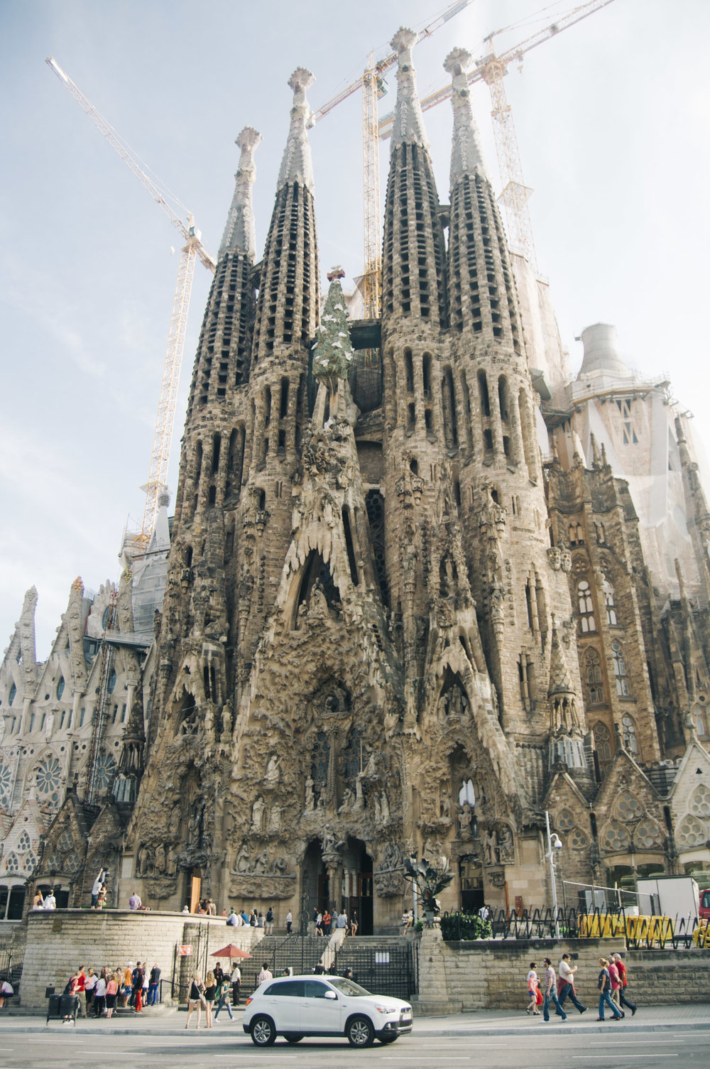 Sagrada Família - La Sagrada Familia, one of the world's most famous churches, designed by the renowned architect Antoni Gaudi, stands proud in Barcelona. Although it is a central and highly important church in the Catholic world, La Sagrada Familia acts as a center of spirituality in which harmony, peace, and love can be shared by every individual regardless of their beliefs. Each one of the 18 turrets and the four spectacular façades has a symbolic value behind its stunning beauty. Furthermore, visitors can see Gaudi's crypt and may climb one of the towers and see Barcelona from high above.