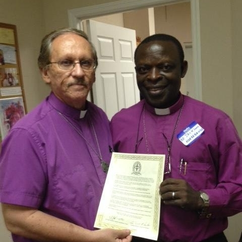 Archbishop Russell McClanahan having signed an Inter-Communion statement with The Right Reverend Jackson Nzerebende Tembo Bishop Of the South Rwenzori Diocese of the Anglican Church of Uganda- a member of the Anglican Communion.  .jpg