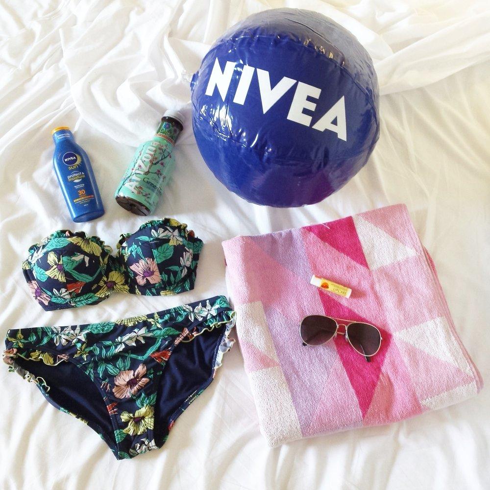 What's in my beach bag? Nivea sun cream, beach towel, bikini, sunglasses
