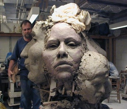 Sculptor Barney Hodes at work