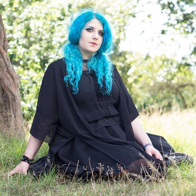 Goth summer in the city! Throwback to last summer's Photoshoot with @juliamascetti. This was my favourite pic of myself . Still can't get over how long my hair used to be.. 🖤🦇☀️ 📸 by @emily_v_photos  #alernativefashion #bluehair #mermaidhair #altmodel #gothicc #gothmakeup #gothgirl #gothgoth #gothinthesummer #summeringoth #summergoth #killstar #disturbia #docmartens #girlswithpiercings #girlswithtattoos #poppunkgirl #emogirl #warpedtour #vans #animehair #allblack #summerinthecity #witchy #waterwitch #stregha #witch #alternativegirl #instagoth