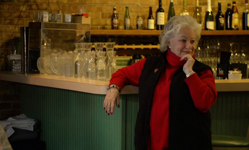 Ina Pinkney looks on lovingly at her full dining room, days before its closing